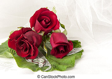 red roses and wedding rings - a red roses and wedding rings...