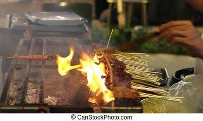 Hawker Vendor Grilling Satay - Street Hawker Vendor Grilling...