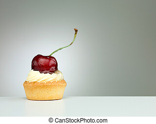 tempting cherry fruit tart - close-up of a tiny tart with...