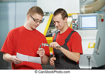 industrial workers at tool workshop - manufacture technician...