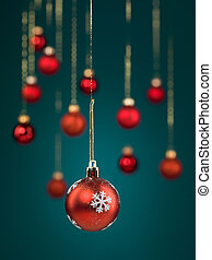 red christmas ball with snowflakes - closeup of hanging...