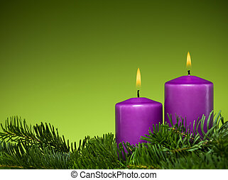 holiday purple candles - closeup of two burning purple...