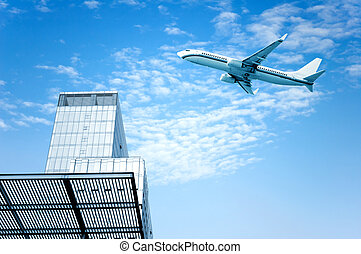 City high-rise - High-rise next to a passenger plane flew...