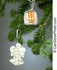 handmade decorations on christmas tree - closeup of two...