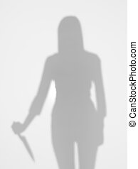 female silhouette holding a knife behind diffuse surface -...