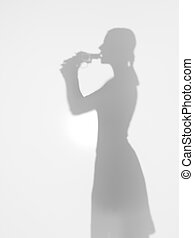 woman committing suicide with gun, silhouette, side view -...