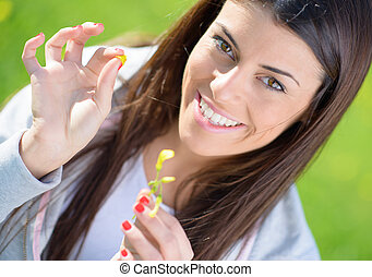Young Woman Picking Leaf - Portrait Of Young Woman Picking...