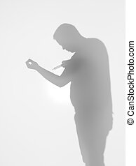 drug addict holding a syringe, silhouette - side view of man...