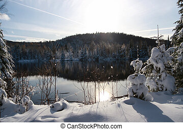 winter scene abroad a lake in rural country of Quebec,...