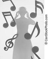 woman listening to music, silhouette - woman standing and...