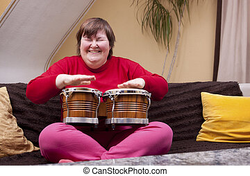 Mentally disabled woman with music therapy - Mentally...