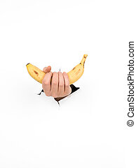 male hand holding a banana - close-up of male hand holding a...