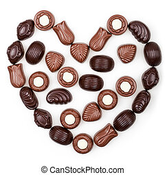 Heart from chocolate candies isolated on white background