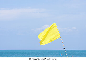 Yellow flag for beach weather