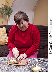 Disabled woman makes herself a sandwich