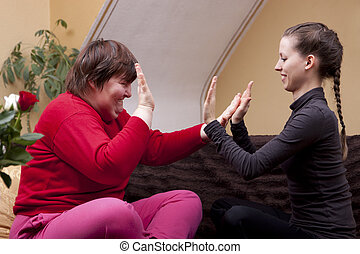 Two women making rhythm exercises - Two women, one of them...
