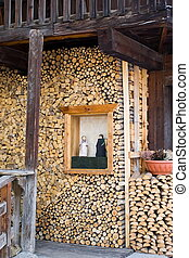 Woodpile - Sacred statues in a woodpile