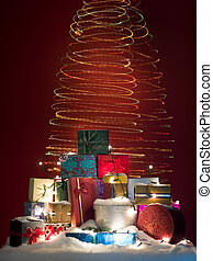 twirly colorful christmas lights with presents - a pile of...