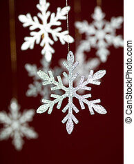 silver snowflakes with glitter - closeup of hanging...