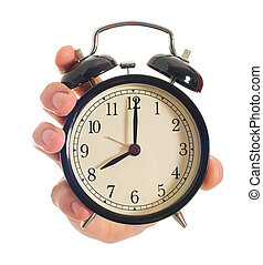 Human Hand Holding Alarm Clock On White Background