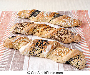 Twisted bread - Three twisted loaves of white bread with...