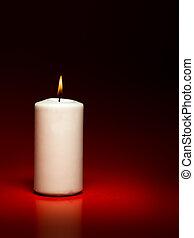 white burning candle - closeup of single white burning...