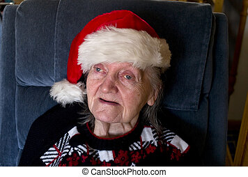 Santa Hat - An Elderly women in the Christmas spirit with a...