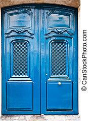 French blue wooden door in Paris, Italy