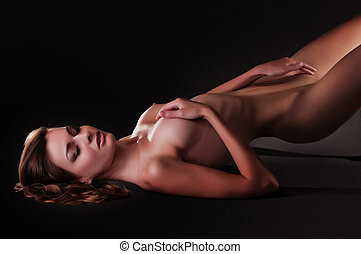woman with a beautiful figure - naked woman with a beautiful...