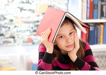 Burnout - Girl with a book on her head as a symbol for a...