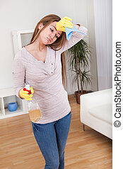 Young Woman Cleaning House - Portrait Of Young Woman Doing...
