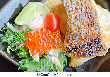 seafood and salad - top view of fish egg with salad and...