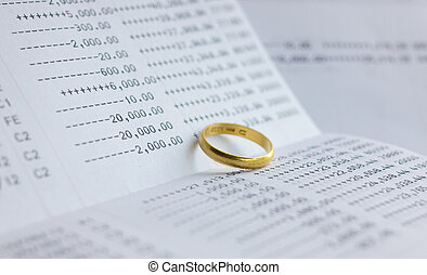saving account Passbook with gold ring - Close up of saving...
