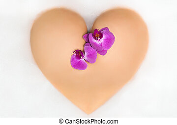 female Booty in shape of a heart with orchid