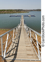 Wooden walkway serving Amieira pier on the banks of the...