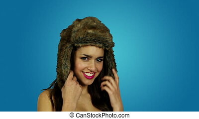 woman winter hat - brunette happy woman wearing winter hat...