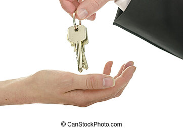 Handover of house keys - Man handing house keys over to a...