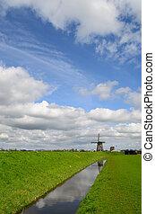 Windmill under a dutch sky - Dutch clouds in the sky over a...