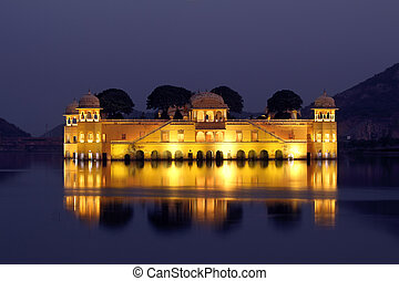 jal mahal palace on lake at night in India - jal mahal...