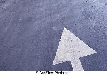 arrow sign. - Road, with white arrow sign.