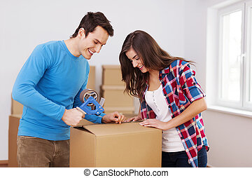 Loving couple packing boxes