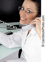 side view of smiling doctor talking on phone