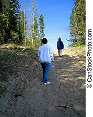 Walking up the sandy trail - Two sisters out on a hike for...