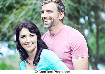 Happy Couple - Portraite of a happy couple outdoors in the...