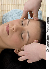 top view of woman taking head massage - top view of young...