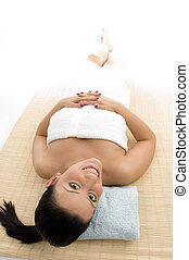 high angle view of laying woman going to take massage