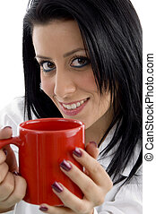 front view of smiling doctor holding mug