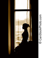 Girl silhouette - The silhouette of the girl sitting in the...