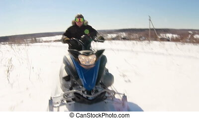 Man on snowmobile in winter