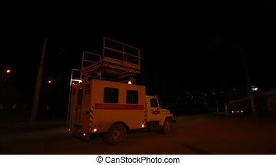 Repair truck on a road at night